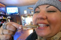 eating deep fried smelt